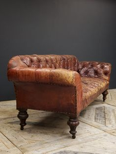 Superb red leather Chesterfield sofa. Raised on turned and carved mahogany legs. English circa 1860. H:71 W:205 D:87 CM Seat Hight 40 cm