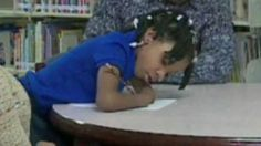 A seven-year-old girl from Virginia who was born without hands wins a US national handwriting contest.
