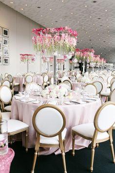 Photographer: Mango Studios, Via Rebecca Chan Weddings & Events; Stunning pink wedding reception with unique floral centerpiece;