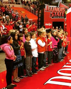 Shout out to students from District 87's Sheridan Elementary school for singing our National Anthem at #RedbirdArena this week for an @IllinoisStateU Basketball game.  We spot several of our #littlebuddies in this photo! Congrats on a job well done everyone!  @ISURedbirds @Redbird_Basketball @ISUWomensBasketball #CollegeMentorsForKids #CollegeMentors #FutureRedbirds by ilstu_cmfk