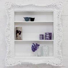 they make it sound so easy...1.find an old picture frame 2.custom build a shelf to fit 3.paint it