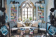 Working with architect George W. Sweeney, interior designer Friederike Kemp Biggs refashioned a New York penthouse for herself and her husband, Jeremy. Sweeney added the arched transom window that streams light into the home office.