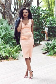 """Try a Sexy and Ladylike Longer Hemline """"This dress is doing me lots of favors! It fits like a glove and makes me look incredibly shapely despite its midi length.""""  —Ria, Ria Michelle"""