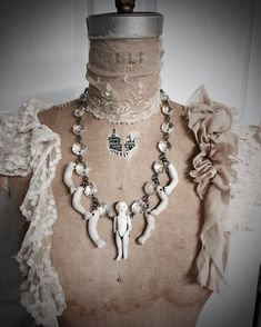 Bohemian Antique Baby Doll Parts Necklace by Louise by louiseblack