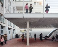 Image 1 of 14 from gallery of Arc en Ciel School / Label Architecture. Photograph by Stijn Bollaert Public Architecture, School Labels, Concrete Structure, Ground Floor Plan, New Classroom, Outdoor Spaces, Playground, Outdoor Gardens, Facade