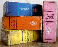 bookbricks and many more ideas for decorating with book themes...or actual books.  Only please make sure the 'old' book you are tearing up to make into a light or a clock is not a first edition!!!!!
