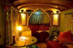 Bohemian style bedroom with Art Nouveau woodwork framing the bed.