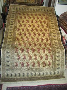 "An Antique Persian Kashan carpet with paisley design. Here it is in full view. Carpet Code: AS21-177. Size: 7'0"" by 4'6"" (214cm by 137cm). Age: Over 70 years old (c)1940"