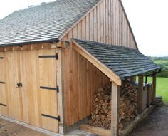 rustic sheds with porch | Double bay garage with playroom.