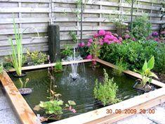 Google Image Result for http://perfectgardeningtips.com/wp-content/uploads/2010/05/pond-small-backyard-water-garden-landscaping1.jpg