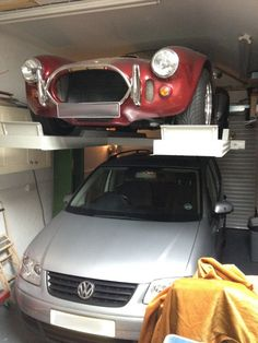 Single Post Parking Lift  Makes best use of available space and provides unobstructed access at floor level underneath the raised car
