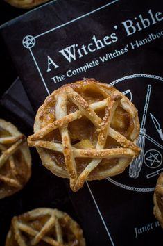 A mini, pentagram topped vegan apple pie on top of a witches' bible book. A mini, pentagram topped vegan apple pie on top of a witches' bible book. Halloween Apples, Halloween Desserts, Halloween Stuff, Spooky Halloween, Halloween Crafts, Halloween Party, Halloween Decorations, Vegan Treats, Vegan Desserts