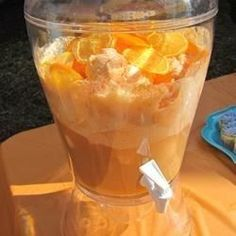 This is the easiest punch recipe ever. It was a big hit at my sister's bridal shower. Simply pour ginger ale over orange sherbet and orange juice concentrate.