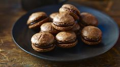 """Chocolate macaroons w. chocolate ganache - Raymond Blanc reveals the secrets to the perfect macaroon, one of the benchmarks by which a good patisserie is measured. You may need a little practice to get them right but, as M Blanc says, """"every mistake will still be delicious. Trust me; I know!""""   Equipment and preparation: You will need a kitchen mixer, a sugar thermometer and a piping bag fitted with an 8mm/¼in nozzle."""