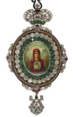 A paste-set silver-gilt and mother-of-pearl panagia , Andrei Bragin, St Petersburg, circa 1890 centred with a painted plaque of the Mother of God of the Sign within green, white, purple and red pastes, 84 standard, on a silver-gilt link chain, struck AS (Cyrillic), Moscow, in a fabric-lined retailer's case for Vasilii Sbitov, St Petersburg height of pendant 17cm, 6 3/4 in.