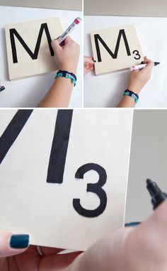 DIY | giant scrabble tile table numbers (a tip about a paint pen or sharpie bleeding into your wood. I usually use a water based polycrylic as a sealer. If you put a coat of this on your board before you paint your letters, then no bleeding issue. Then top with one last coat of sealer.