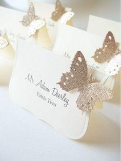 Glittered Butterfly Escort Cards on Preston Bailey's Bride Ideas