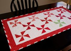 from the blue chair: Pinwheel Table Runner with Candy Cane Binding (GIVEAWAY CLOSED)