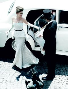 Here's how to make an entrance. Anne Hathaway. Vogue. Vintage car.