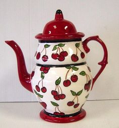Sweet cherry teapot reminds me of country weekends with leisurely tea time.