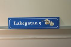 A blue aluminium sign with printed motive. www.jcgt.se