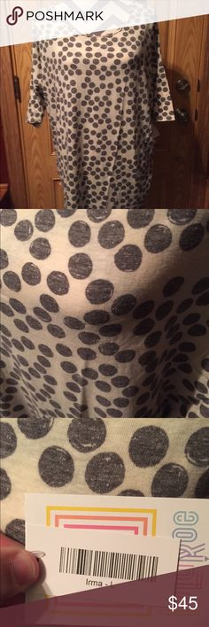 "LuLaRoe IRMA Size Large Grey & Cream NWT! Don't miss out on this amazing, true Hi-Low styling of Irma! Great to pair with leggings or jeans, Irma covers all of your ""assets"" to the fullest, ensuring a comfortable & cool fit for all day! This print is a super soft grey & off white/cream polka dots. REMEMBER to size DOWN when purchasing an Irma as these fit 1-2 sizes SMALLER than what you typically wear! NWT & awesome for fall! LuLaRoe Tops Tees - Long Sleeve"