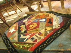 this is a wool appliqued crazy quilt, but would make a great hooked rug too!