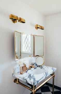 So fancy! Brass and marble bathroom details