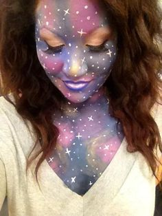 Bring in the whole galaxy with your Halloween makeup. This nebula galaxy inspired makeup looks simply gorgeous and star studded.