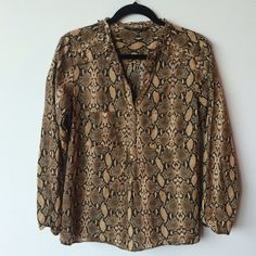 Zara Python snake print cotton blouse ZARA snake print blouse GORGEOUS!  Preowned- excellent condition. Made of 100% cotton. Size Large. Measurements: underarm to underarm is approximately 20 inches flat across. Back of neck to bottom of hem is approximately 25 1/2 inches. Buttons are antiqued brass and gold tones. Zara Tops Blouses