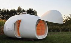 "A Belgian architecture firm created the egg-shaped ""blob VB3″ as a multi-purpose, mobile pod that can be used as an office, guestroom, or… garden house. The home is made of polyester, sports an ultra modern, clean design, and provides enough room for storage and sleeping."