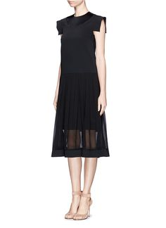 The simple black dress is given an aspirational spin in this relaxed and layered number from Ellery. Featuring a dropped waistline and a full voluminous skirt, dress to impress with its delicate protruding sleeve caps and integrated satin trims. Wear it with a slim belt to bring in the waist for a more fitted and voluptuous look.