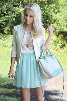 I love the pastel light blue skirt contrasting with the white embroidered lace top and matching cardigan.
