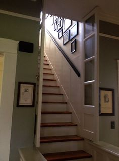 stop heat escaping upstairs by adding a full door at bottom of steps. if possible, use a pocket door.