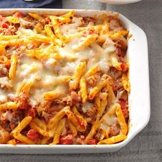 Eggplant Sausage Casserole Recipe -If you want your kids to happily eat their eggplant, serve it in this lovely layered casserole. Our whole family enjoys it. Always a popular potluck item, it's a great company dish, as well. —Carol Mieske, Red Bluff, California