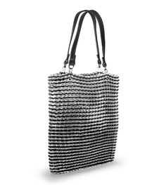 Stylish Tote made from soda can pop-tops! Available through Escama Studio in Brazil, an outfit pledging to support their artisans with a fair-working wage. Great for ur charitable friend & as a fun summer bag <3