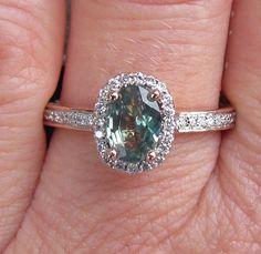 Alexandrite 14k Rose Gold Diamond Halo Engagement Ring Rare Gemstone Engagement Ring. $1,550.00, via Etsy.