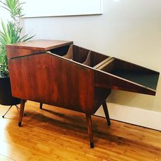 Sweet and unique Midcentury Modern record cabinet  a beautiful wooden creature that eats your vinyl...mmm