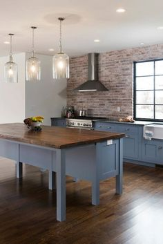 Open-base island. Make it look more like furniture/ table for a lighter feel in a small space. Exposed brick. Glass pendants. Grey kitchen cabinets.