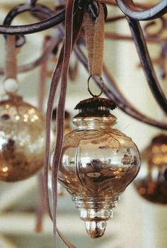 Christmas tree baubles suspended from a chandelier.