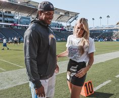 going on the field for the chargers pre-game warm-up ________________________________________________________ Comment down below 1 video you want to see from. Football Wags, Football Couples, Football Girlfriend, Nfl Football Games, Football Outfits, College Football, Football Season, Nfl Wives, Nfl Oakland Raiders