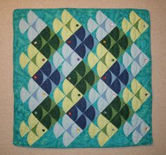 Light colored fish swim to the right. Dark colored fish swim to the left in this Escher like Fish Quilt or Wall Hanging by ThimbleJoys, $120.00