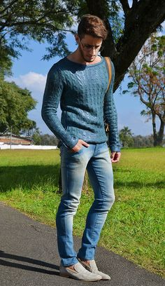 The cable knit sweater, in a shade of cerulean sure to please Miranda Priestly, looks great with skinny distressed blue jeans and neutral loafers.  The glasses also look great!