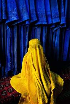 'Woman in canary burqa', 2002. | 24 Striking Pictures Of Afghanistan By Photojournalist Steve McCurry