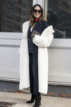 A long white coat paired with a pantsuit.