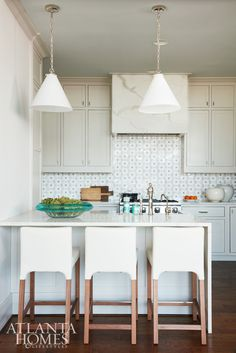 The petite kitchen is big on style with a custom tiled New Ravenna backsplash in a flower pattern.