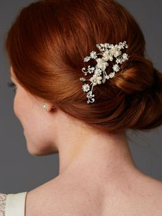 A bouquet of freshwater pearls, crystals and seed beads create this whimsical bridal hair comb with soft feminine appeal. Add floral perfection to your wedding day hairstyle with this gorgeous light s