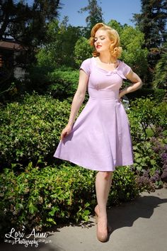 Beverly Dress in Lavender Lynette Fabric - A sweet empire waist, round collar with self tie, full swing skirt, and princess seams to hug the body make this demure little number from Heartbreaker a perfect day dress for work or fun.  The fabric is a breezy rayon and linen blend in a stunning lavender and the fit is fantastic with a back tie at the waist.