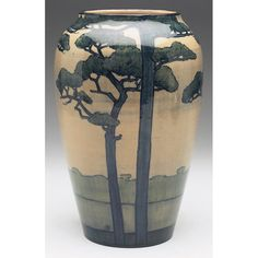 Fine and early Newcomb College vase, large tapered shape covered in a high glaze, nicely painted landscapewith numerous pine trees in bold colors, executed by Amelie Roman