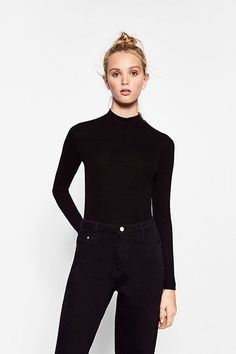 """""""I love these funnel-neck tops from Zara in black — I probably have about three from there and two similar ones from H"""